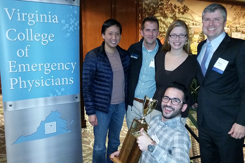 Emergency Medicine residents won this year's Virginia College of Emergency Physicians resident Jeopardy challenge. In front is Kyle Resendes, MD (PGY 3). From right are Barry Knapp, MD, Program Director; Kean Feyzeau, MD (PGY 2), Jason Jennings, MD (PGY 3), and Bruce Lo, MD, Associate Professor.